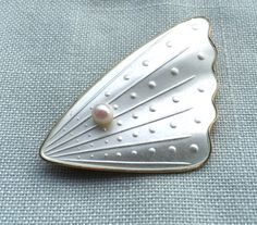 White silver enamel brooch by Norwegian designer Hans Christian Østrem. Read more about the designer at web page: http://solvstempler.no/hans_christian_oestrem.html