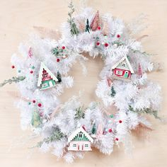 Add some magic to your front door this holiday season with this DIY Christmas Village wreath!