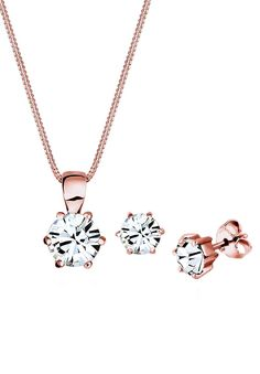 Mit klassischer Eleganz und funkelnd femininem Stil wird dieses Set aus rosé-vergoldetem 925 Sterling Silber in deinem Schmuckrepertoire unverzichtbar werden. Die dezenten Kristalle von Swarovski wirken edel und weiblich. Erweitere deine Schmucksammlung um ein unverzichtbares Schmuckensemble aus einer Halskette und Ohrsteckern und genieße das fantastische Gefühl von wertigen Materialen und mode...