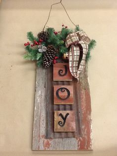 Barn board joy sign, I like the use of metal layered on wood Christmas Signs, Christmas Art, Christmas Projects, Winter Christmas, Christmas Wreaths, Christmas Ideas, Barn Board Crafts, Barn Board Projects, Barn Board Signs
