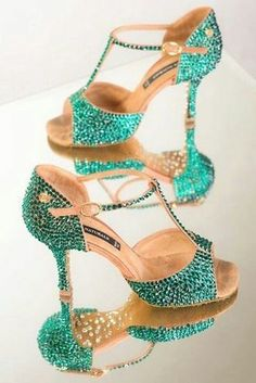 Peep toe T-straps are fun and funky covered in teal crystals