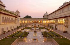 The Rambagh Palace of Jaipur was erected in 1835 for the queen's favorite handmaid. Nearly a century later, it was converted into a palace for the Maharaja, and the lovely structure is often endearingly called the Jewel of Jaipur. The royal family opened the palace as a luxury hotel in 1957.