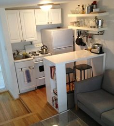 Tall bar adds dining space and work space, and the shelves above add storage. Plus it helps define the room.