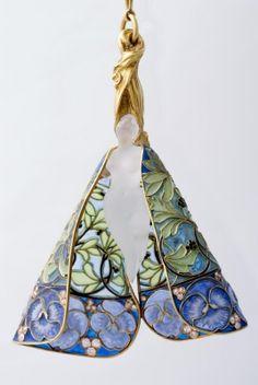 An Art Nouveau pendant by René Lalique, circa 1900, Paris. Composed of gold, diamond, corroded glass and plique-à-jour enamel.