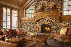 Southwestern style river rock fireplace.