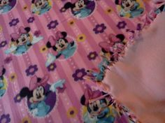 this is large 50 x 50 handmade fleece minnie mouse blanket with a pink backing  ..very nice and soft