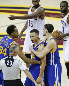 Stephen Curry is held back by Shaun Livingston and Klay Thompson as Curry argues with referee Jason Phillips after being ejected in Game 7 of the NBA Finals in Cleveland Ohio on June 16, 2016.