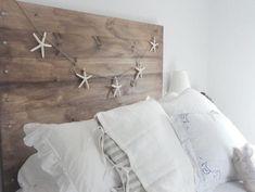 DIY headboard - two verticals, one board cut in half lengthwise at angle for mounting, add thin sheet to back of top cleat to  create hidden tray at top