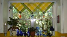 Window treatments on the cheap.  Cloth napkins, curtain rod and time - that's all!