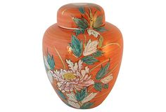 "A pretty rust-colored ginger jar from Japan with a floral motif. Marked with sticker ""Made in Japan."""