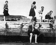 Grand Duchesses Tatiana, Maria, Olga (down) and Anastasia playing with Louis mountbatten.