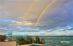 Of Wings and Rainbows - double rainbow from Akumal.