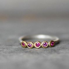 The subtle differences in these side-by-side stones —one ruby, two garnets, and two pink sapphires — give this rosy ring extra depth. #etsyjewelry