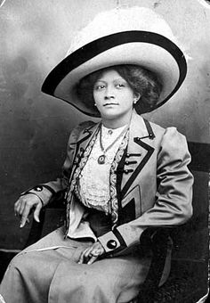 Woman wearing suit and hat.. circa 1915