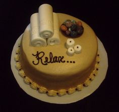 """Spa Cake - This spa cake was a chocolate cake with peanut butter buttercream with fondant towels and candles, and some candy rocks for the """"spa stones""""."""