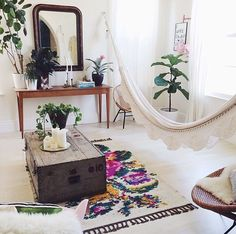 Modern bohemian living room with a hammock and trunk coffee table I'm just saying...it can be done. #Bohemianlivingrooms