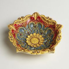 """It's easy to nest when your vessels are ready for the task, too. Lay any pretty thing inside our vibrantly hand-painted 6"""" Floral Shaped Painted Tidbit Dish and its recessed cool red interior. Dressed up for Diwali, the annual Indian """"Festival of Lights"""", this sequined and jeweled dish can accommodate all your celebrations. Available at Cost Plus World Market >>#WorldMarket #BestExoticMarigold Sweepstakes #LoveBlooms"""