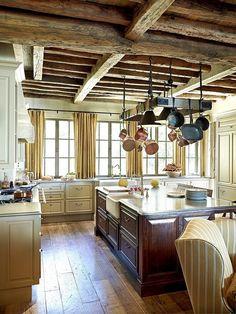French Estate kitchen, wood floor, open beams, pot rack...