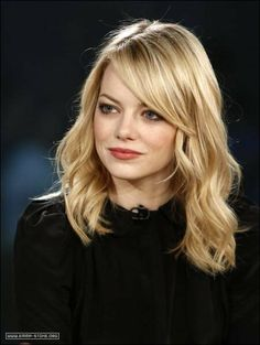 Side swept bangs, loose waves