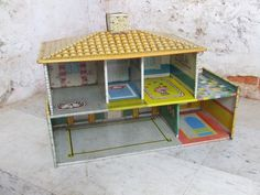 1950s 1960s Vintage Doll House Spanish Colonial Clay Tile Roof Metal Lithograph Cohn Superior Toys. $48.00, via Etsy.