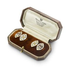 A pair of Faberge ruby,rose diamond and enamel cufflinks