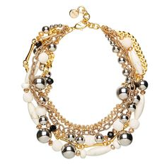 Mixing shiny and raw surfaces, this statement neckpiece will work tonal and textural contrast into your minimalist winter look.