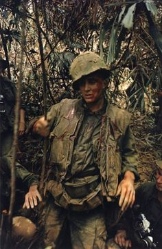 Wounded GI near DMZ, 1966. Photo by Larry Burrows
