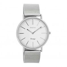 Koop dit OOZOO Vintage horloge Zilver C7395 horloge online in onze webwinkel.                     Dit is een dames horloge met een quartz uurwerk.                             De kleur van de kast is zilver en de kleur van het uurwerk is wit.                             De kast is gemaakt van staal en de band van het horloge van staal.                             Het uurwerk is analoog en er wordt gebruik gemaakt van mineraal.                                       Wij zijn offic...