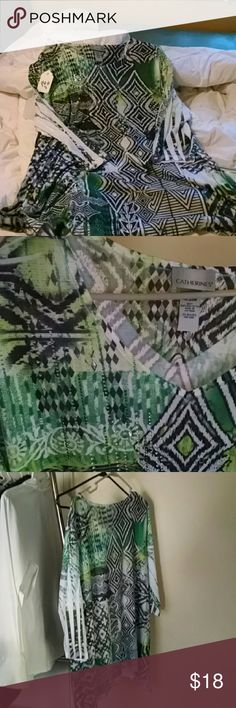 "Womens Catherine 's Brand Tunic 3/4 length sleeves. Size 18/20 in excellent condition  pretty black and green trouble pattern with a little ""bling"" as shown in picture 3.  Lightweight prefect for summer or fall. Catherines Tops Tunics"