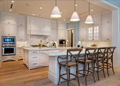 White Kitchen - wide plank hardwood medium - Vero Beach - traditional - kitchen - melbourne - Busby Cabinets love the wood chairs Double Island Kitchen, Kitchen Layouts With Island, New Kitchen, Kitchen Dining, Kitchen Decor, Kitchen Ideas, Kitchen Designs, Dining Rooms, Layout Design
