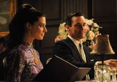 Jessica Pare and Jon Hamm in Mad Men.  Love the hair!