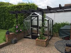 A Juliana Compact 75 greenhouse in silver / black with stable door