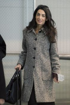 Amal Clooney bundles up as she gets ready to fly out of Euro Airport Basel-Mulhouse-Freiburg on Wednesday (January 28) in Saint-Louis, France. She wore a grey tweed coat with her Paule Ka bow pumps. The bag is by Dior.