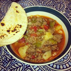 Picadillo con papas -brown 2lbs ground beef with salt and pepper then drain -add a can of whole peeled tomatoes, chop the tomatoes before adding  -3 cups warm water -Generously sprinkle tomato bouillon for taste -2 sliced peeled potatoes (quartered, diced) -1/2 white onion cut in chunks or diced -1 green bell pepper cut in chunks or diced  Bring to a boil and let simmer for 45 minutes. Enjoy with some warm tortillas!