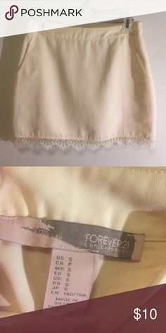 Forever 21. Size small. Ivory skirt. Great condition. Size small. Ivory. 15 inch inseam. Forever 21 Skirts Mini