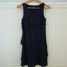 "Banana Republic Navy Blue Dress Beautiful navy dress with asymmetrical tiers from Banana Republic. Brand new with tags.  Comes with extra buttons. Perfect for the holidays! Measures 33 1/2"" in length. Bust 16"" across. Banana Republic Dresses"
