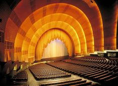 Radio City Music Hall, New York  |  The Great Stage, designed by Peter Clark, measures 66.5 by 144 ft (20.3 by 44 m), and resembles a setting sun.  Its system of elevators was so advanced that the U.S. Navy incorporated identical hydraulics in constructing World War II aircraft carriers; according to Radio City lore, during the war, government agents guarded the basement to assure the Navy's technological advantage.