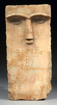 Stele carved with a stylized human face. South Arabian characteristics, alabaster, South Arabian peninsula circa 3rd-1st century BCE
