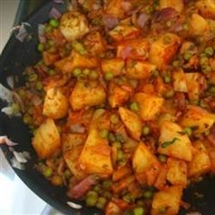 Potatoes and peas are cooked in a tomato sauce with Indian seasonings.(Combine with Aloo Puhjia to refine)