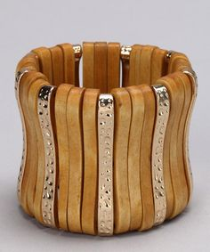 Take a look at this Gold & Tan Casual Chic Stretch Cuff by Felicia LTD on #zulily today!