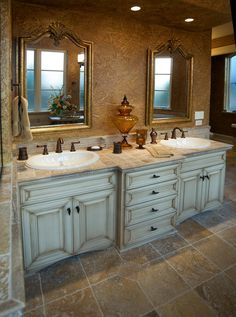 Painting And Distressing Bathroom Cabinets love these painted bathroom cabinets and the lights. what i would