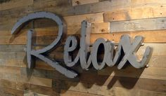"""Relax metal sign. 56 x 24 x 2"""" thick."""