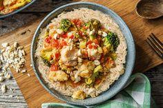 Oosters vispotje met tomaat, broccoli, kurkuma en cashewnoten Recept | HelloFresh