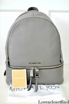 Michael Kors Rhea Zip Large Backpack Silver Dark Steel Grey Gray. The perfect fashion backpack. Great for ladies who are too busy to hold onto a purse or who just like to go hands-free. Loveaclosetfind Purse Sale!