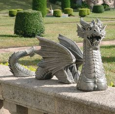 The Dragon of Falkenberg Castle~intricately sculpted dragon statue stretched out over two feet long in your flowerbed! True gothic garden art, this almost lifelike dragon sculpture is complete with scales, wings and a treacherous dragon tail. Cast exclusively for Design Toscano Our gothic dragon statue is hand-finished in faux stone, it arrives in three pieces of quality, cast designer resin.