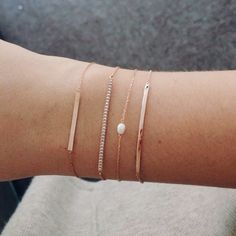 Simple gold bracelets stacked up. Love this look.