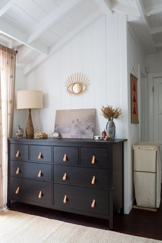 A Small Silver Lake Bungalow That's a Little Bit Rock & Roll black dresser bedroom country panel wall blue