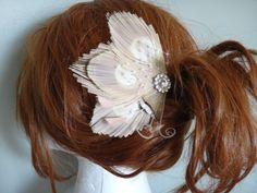 Bridal Ivory peacock hair piece with a rhinestone.