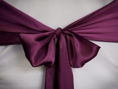 Chair Rentals- Purple Satin Chair Sash. Complete the look with a matching table runner or napkin. Check out our other fabrics at Eventrentalutah.com or follow our board on Pinterest