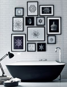 black & white bathroom - great use of artwork